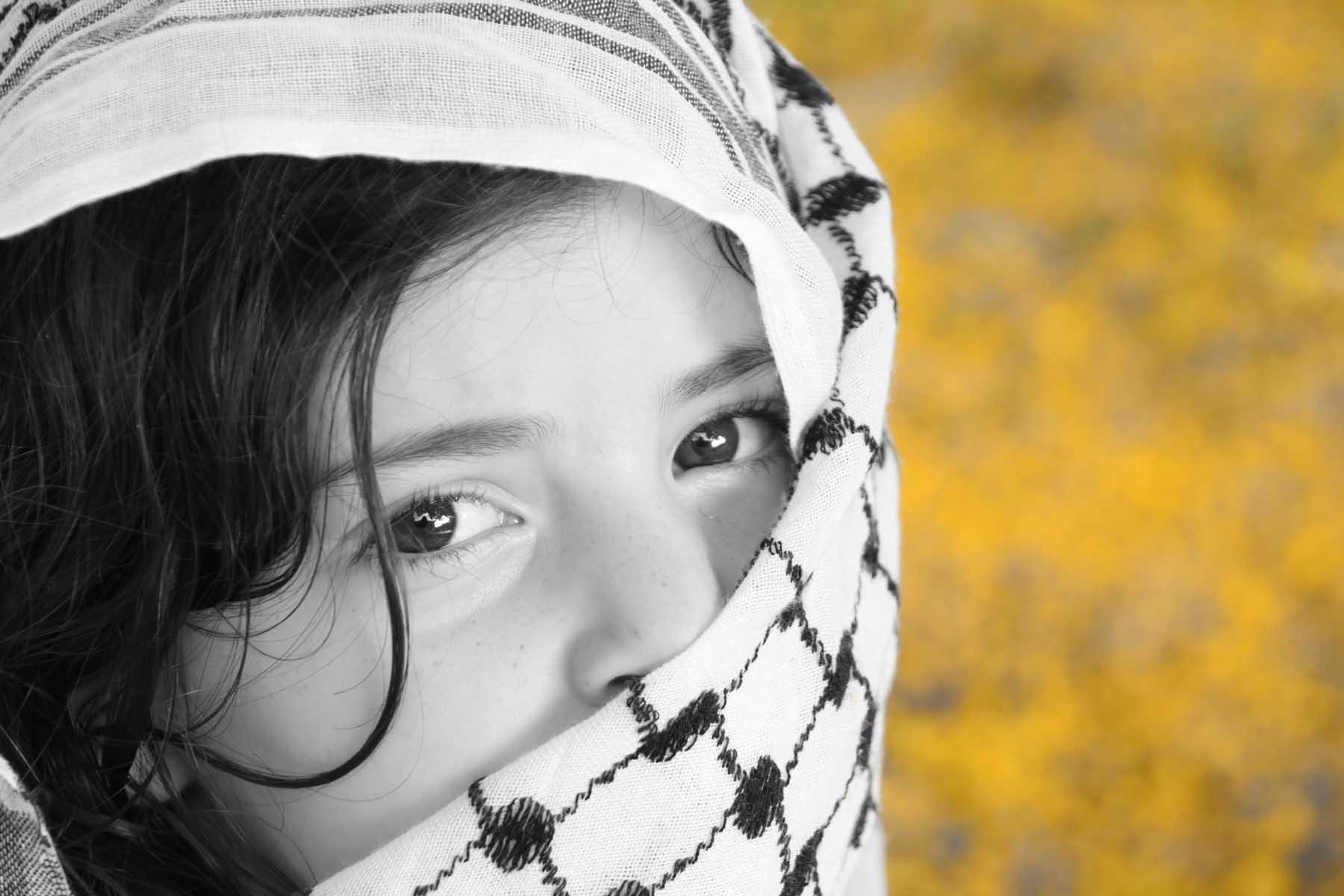 Afghan girl and (Arabic) kaffiyah